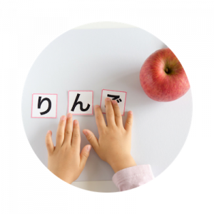 Student studying Hiragana letters during a Japanese class